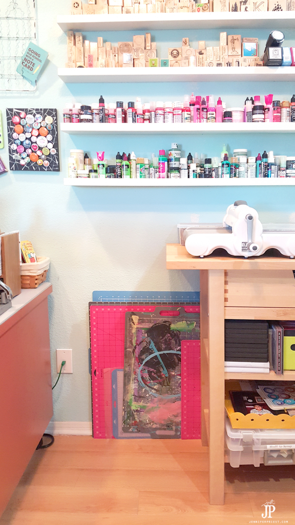 Store craft mats behind a table or bar so easy access. Keep them out of the way and upright when not using them. this craft room tour has the best ideas!