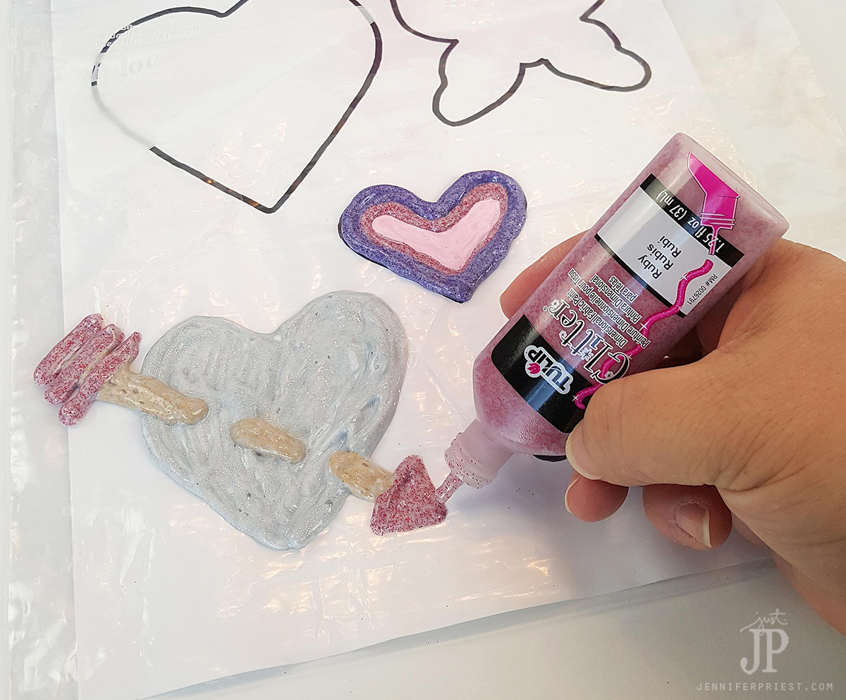 "Use Tulip Glitter Dimensional paint to make window clings- the ""paint"" dries clear so only the glitter shows, like it is floating!"