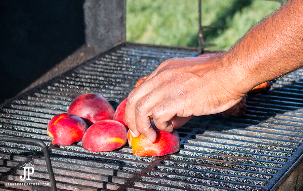 halves of stone fruit on grill