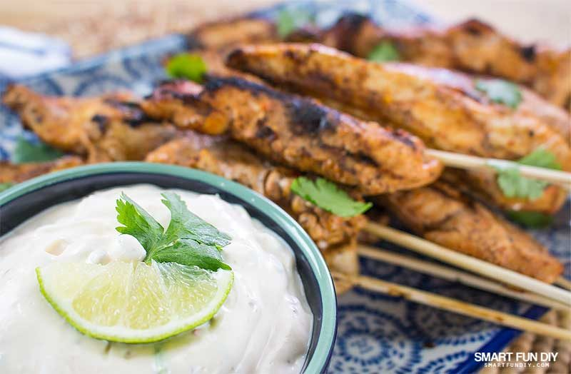 creamy chipotle dip in bowl with platter chicken skewers