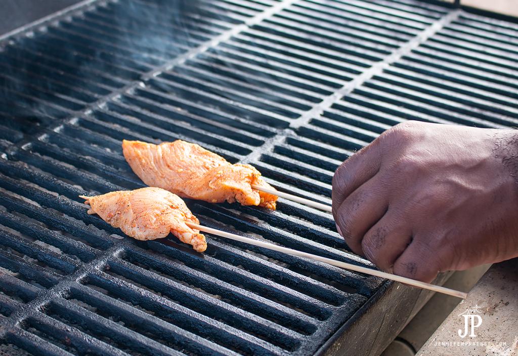 place-chicken-skewers-on-grill-jenniferppriest