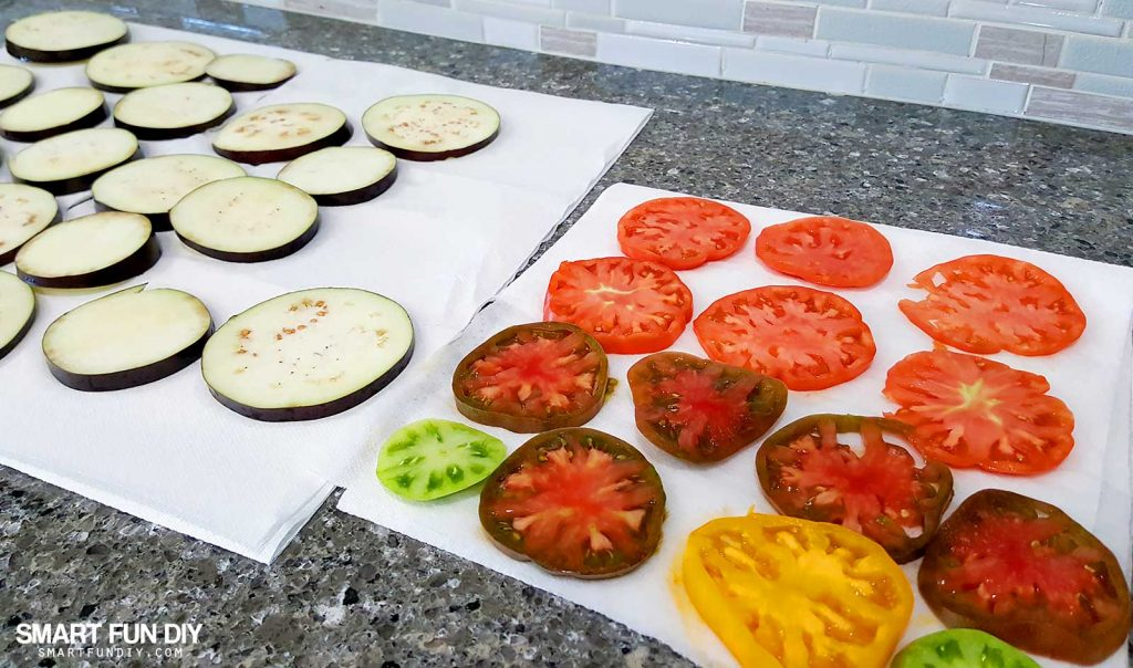 Drain eggplant before grilling. Grilled eggplant and heirloom tomato salad recipe https://www.smartfundiy.com/mothers-day-lunch-grilled-eggplant/ #SoWorthIt