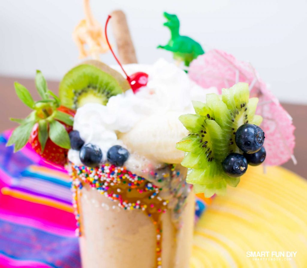 vegan banana date milkshake with fruit and toy toppers