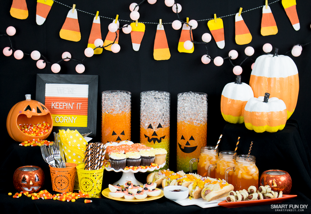 the pumpkins on the right and left of this party spread are on top of boxes tucked under the table cloth can you spot them no one will ever know that