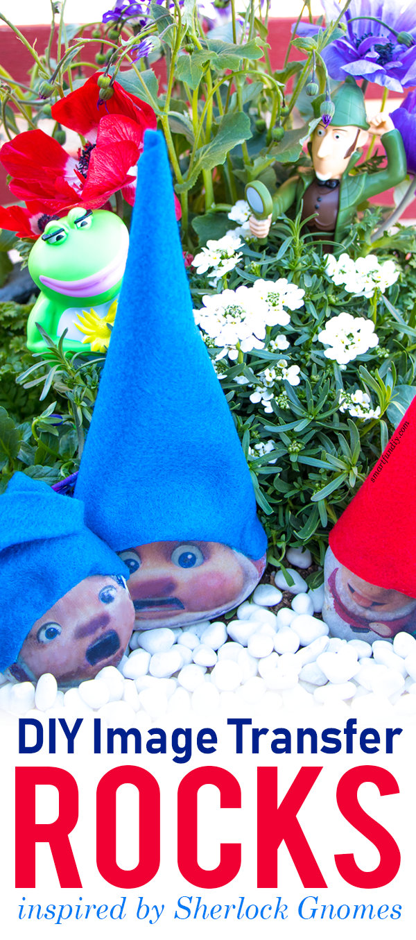 rocks with gnome hats and faces in a flower pot