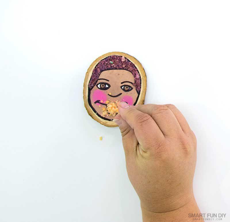 sprinkle crushed cereal onto glue on self portrait