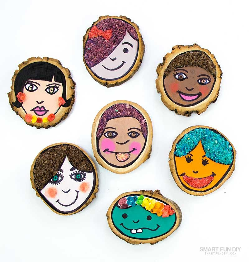 picture of kids self portrait drawings on wood slices