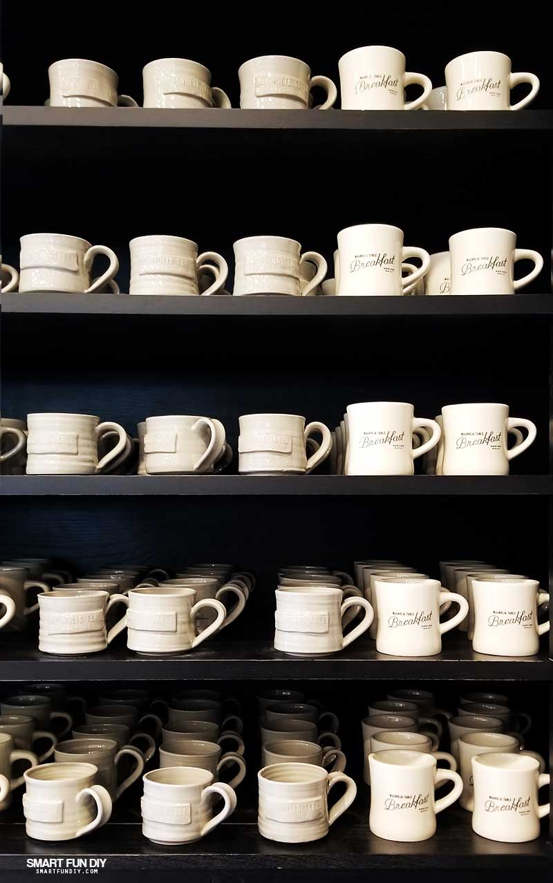 Coffee cup display in Take Away Market at Magnolia Table restaurant