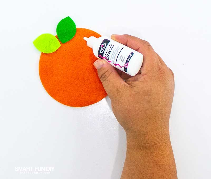 add puffy paint to felt oranges