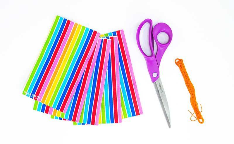 rainbow napkins scissors and orange string
