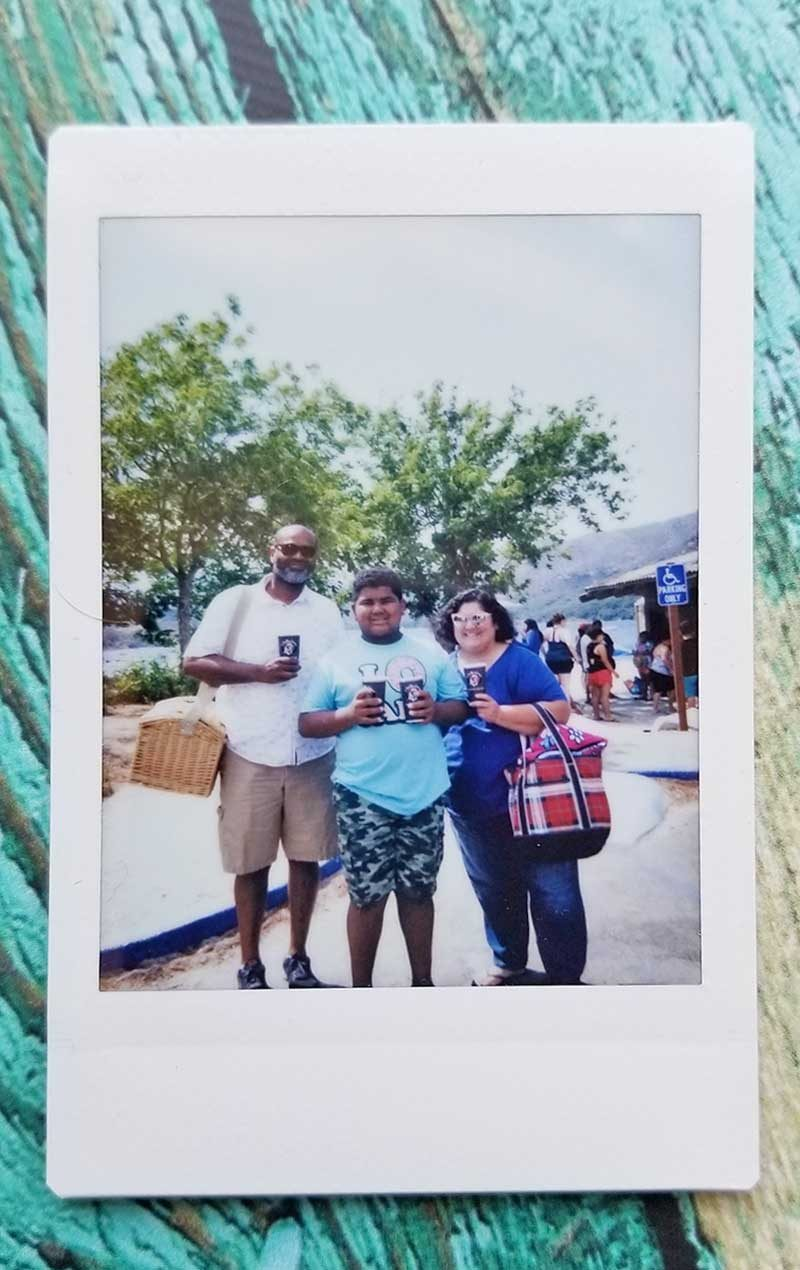 instant camera photo at lake