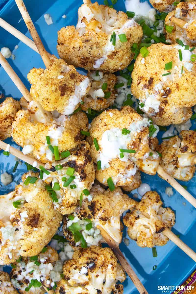 Spicy cauliflower lollipops on a blue platter