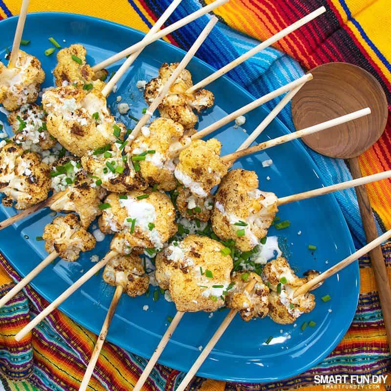Spicy cauliflower lollipops on a platter