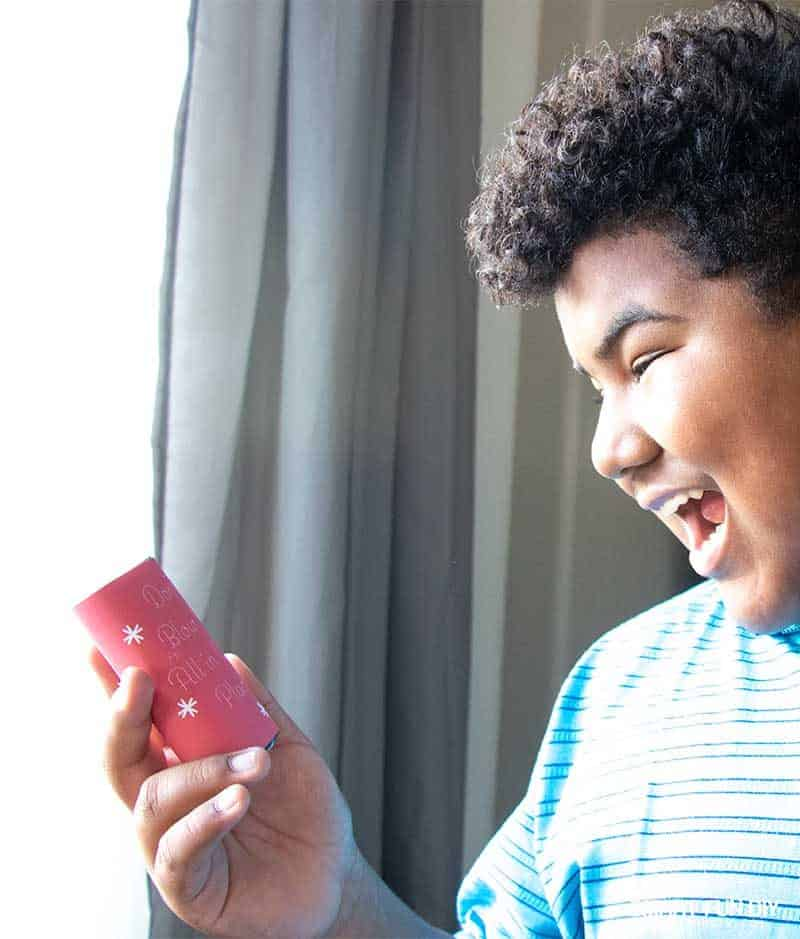 boy reacting to don't blow it all in once place money gag gift idea