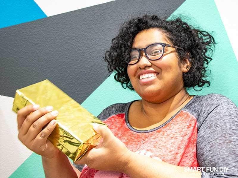 girl reacts to fake gold brick hidden cash gift idea
