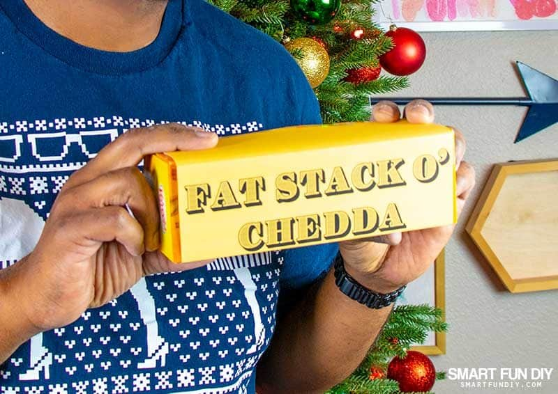 fat stack o chedda gag gift idea - man holding velveeta box with printable label on it