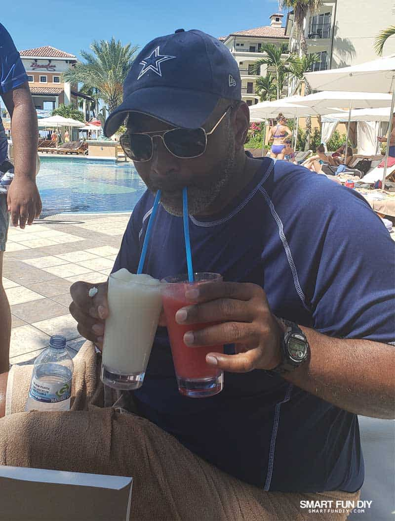 Dad with two drinks at Beaches Turks and Caicos