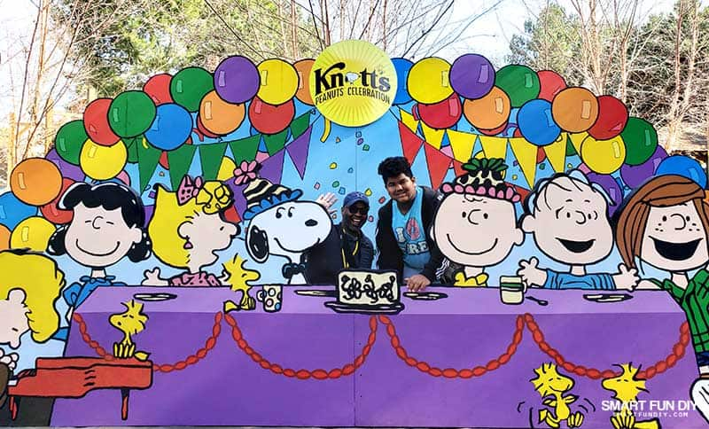 Knott's PEANUTS Celebration birthday party photo opp in Camp Snoopy with father and son