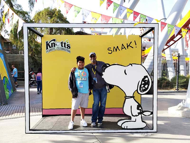 Snoopy photo opp at Knott's PEANUTS Celebration with father and son